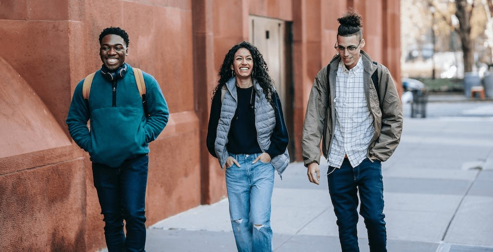 Three college students walking to Finance class together