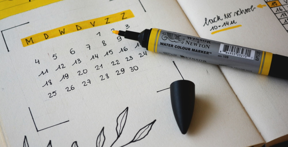 Calendar for planning employee financial wellness promotional topics throughout the year